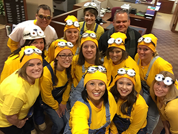 Bank of Washington employees dressed up as Minions for Halloween 2015