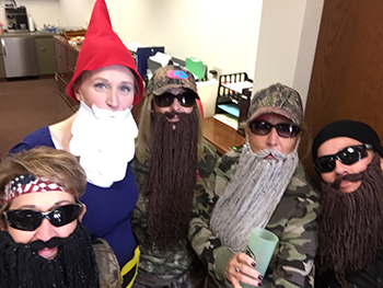 Bank of Washington employees dressed up as Duck Dynasty guys and a gnome for Halloween 2015