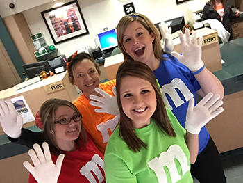 Bank of Washington employees dressed up as M&M's for Halloween 2015