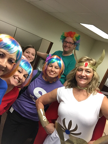 Bank of Washington employees dressed up as Skittles and a superhero for Halloween 2015