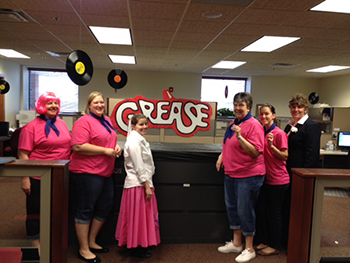 Bank of Washington employees dressed up as Pink Ladies from Grease for Halloween 2015