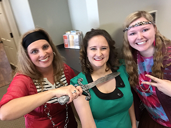 Bank of Washington employees dressed up as a pirate, hippie, and girl from the 20's for Halloween 2015
