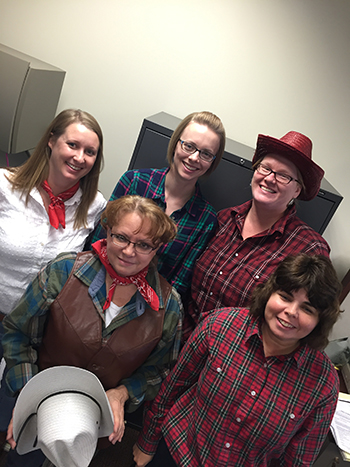 Bank of Washington employees dressed up as cowboys for Halloween 2015