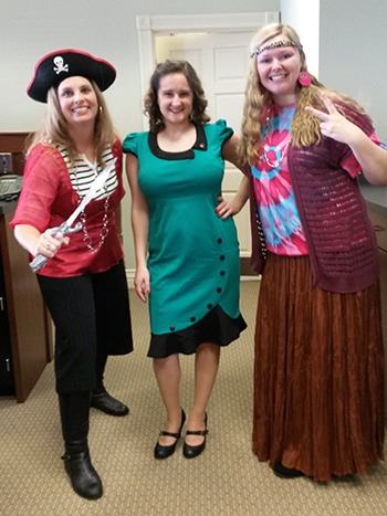 Bank of Washington employees dressed up as a pirate, hippie, and girl form the 20's for Halloween 2015
