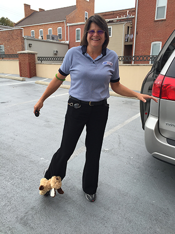 Bank of Washington employee dressed up as a postal worker with dog on her leg for Halloween 2015