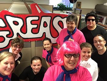 Bank of Washington employees dressed up as characters from Grease for Halloween 2015