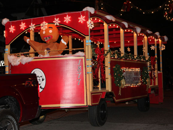 Trolley decorated for Christmas with Gingerbread Man on it in parade