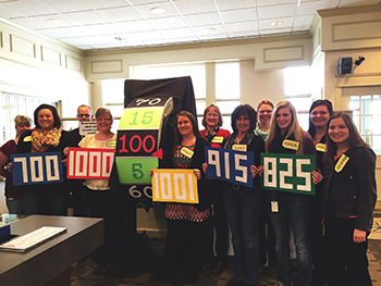 Bank of Washington employees dressed up as The Price Is Right for Halloween 2015