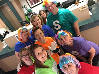Bank of Washington employees dressed up as Skittles and M&M's for Halloween 2015