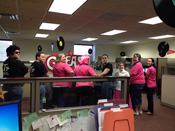 Bank of Washington employees dressed up as character from Grease for Halloween 2015